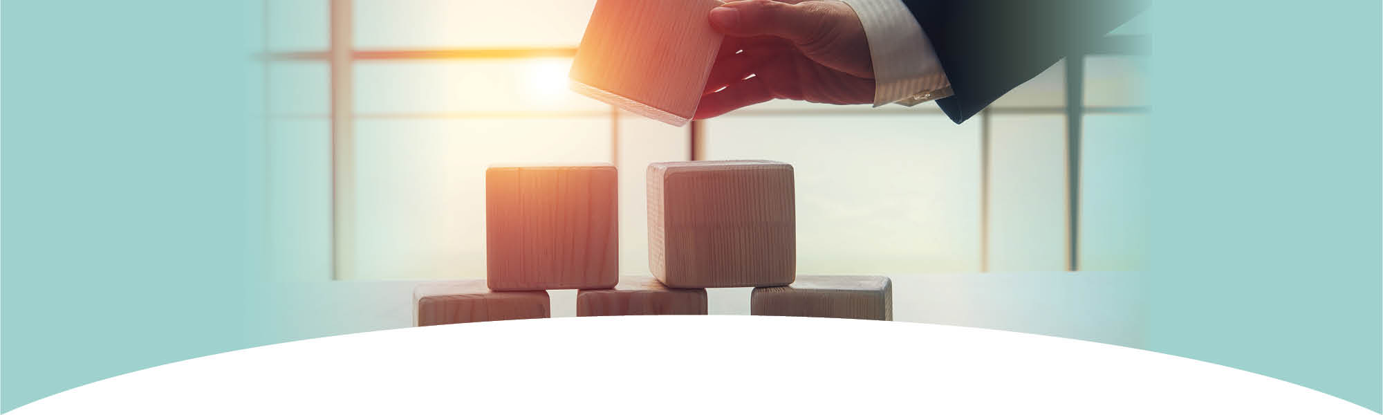 Impact and Special Initiatives - businessman stacking wooden blocks
