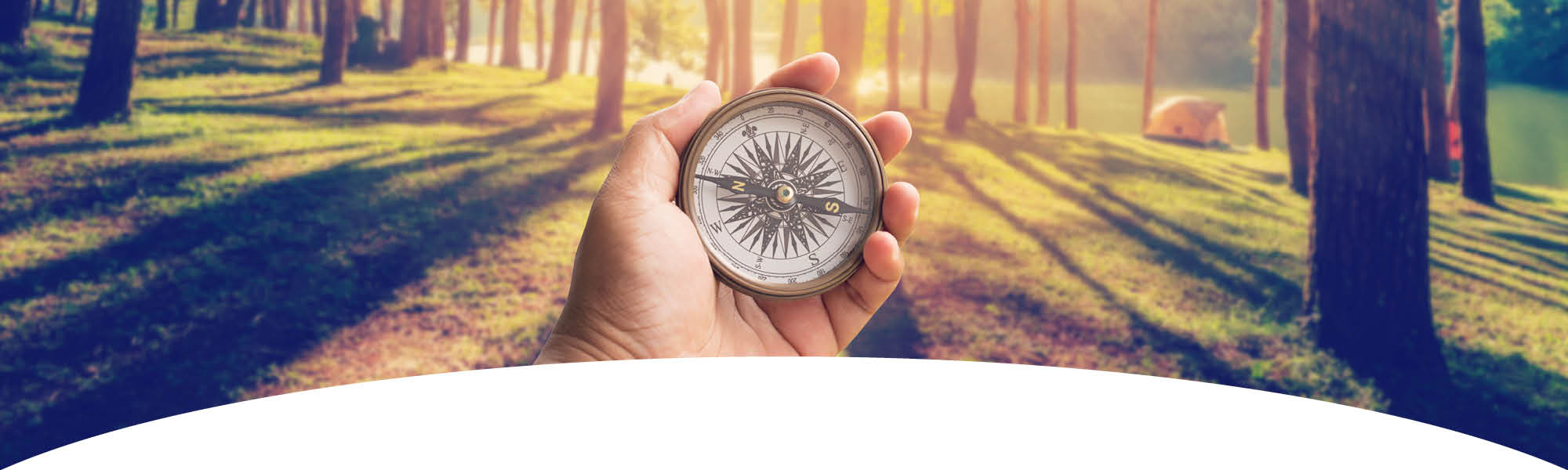 Community Resource Navigator - hand holding a compass in a forest