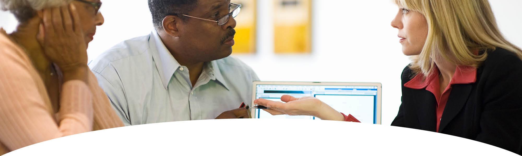 Financial Coaching - businesswoman coaching a couple
